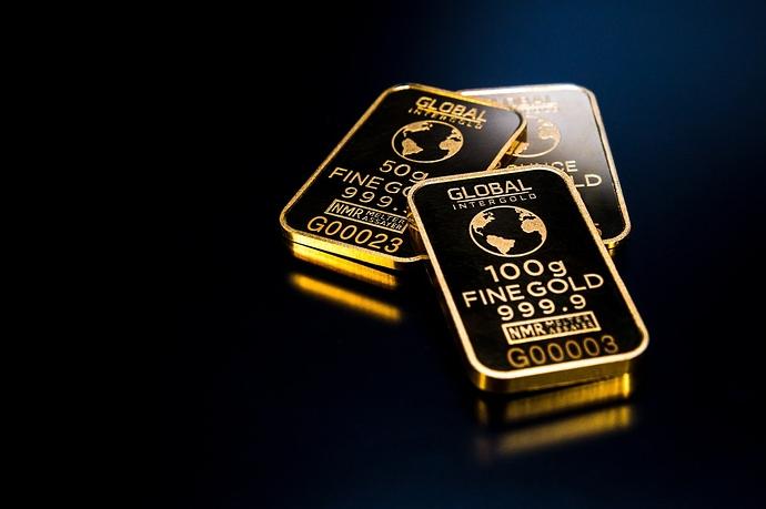 Goldbarren auf schwarzem Hintergrund